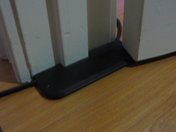 3D Printed Extension cord under-door pass-thru protector by