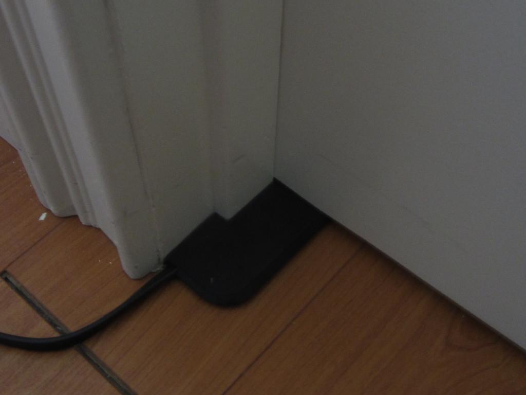 Extension cord under door