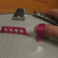 Small 5 string banjo bridge and thumb pick 3D Printing 90884